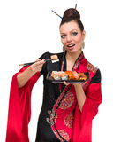 Woman in traditional red dress with eastern food Stock Photos