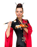 Woman in traditional red dress with eastern food Royalty Free Stock Image