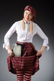 The woman in traditional scottish clothing Royalty Free Stock Photography