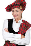 Woman in traditional Scottish outfit Stock Images