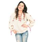 Woman in traditional shirt. Pretty young woman wearing a romanian traditional shirt over white background Royalty Free Stock Image