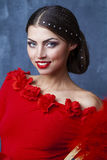 Woman traditional Spanish Flamenco dancer dancing in a red dress Stock Image
