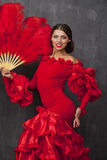 Woman traditional Spanish Flamenco dancer dancing in a red dress Royalty Free Stock Photo