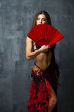 Woman traditional Spanish Flamenco dancer dancing in a red dress Royalty Free Stock Images