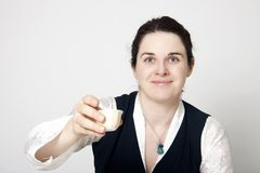 Woman in traditional tibetan dress with cup of tee Royalty Free Stock Photography