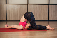 Woman in a traditional yoga pose Stock Images