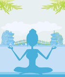 Woman in a traditional yoga pose Royalty Free Stock Images