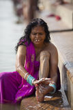 Woman traditionally bathing by the river Ganges in Royalty Free Stock Photography