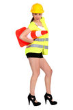 Woman with a traffic cone Royalty Free Stock Photography