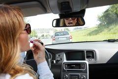 Woman in traffic jam Stock Photos