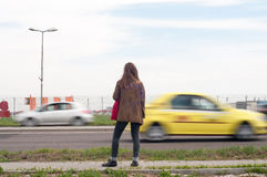 Woman in traffic Royalty Free Stock Images
