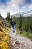 Woman on Trail. A woman walking on a mountain trail stock photos