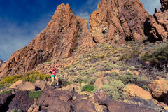 Woman trail runner drinking in inspiring mountains landscape Royalty Free Stock Photos