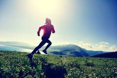 Woman trail runner running on beautiful mountain peak Royalty Free Stock Photography