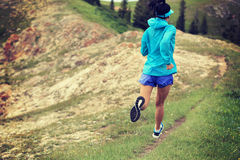 Woman trail runner running on beautiful mountain peak Royalty Free Stock Photos