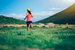 woman trail runner running in mountains Royalty Free Stock Image