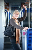 Woman on the train Royalty Free Stock Images
