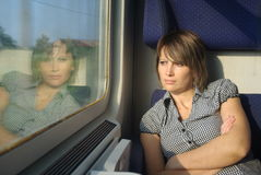 Woman in train Stock Image