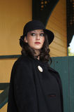 Woman at Train Depot. Beautiful Woman modeling clothing and accessories from the 1930/40's Vintage clothing, hat, and a coat standing at old train station Royalty Free Stock Photo