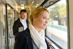 Woman in train looking pensive on window Royalty Free Stock Photography