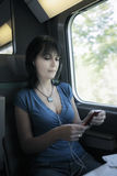 Woman train music Stock Images