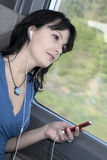 Woman train music Stock Image