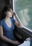 Woman train phone Royalty Free Stock Photo