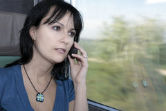Woman train phone Stock Image