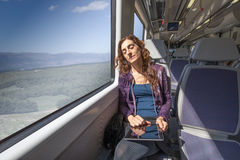 Woman in train sleeping with digital tablet in hands Stock Photography