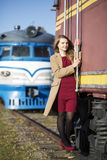Woman at  train stairs hold on boundary Stock Photography