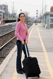 Woman at the train station Royalty Free Stock Image
