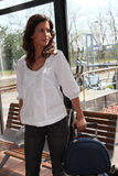 Woman in a train station Royalty Free Stock Image