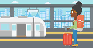 Woman at the train station vector illustration. Stock Photos