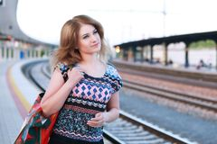 Woman on train station Royalty Free Stock Image