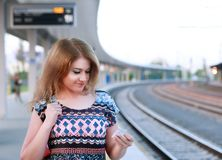 Woman on train station Royalty Free Stock Photo