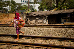 Woman of the train track slums of central Jakarta, Indonesia Stock Photos