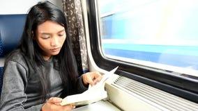 Woman in train stock video