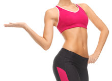 Woman trained abs. Close up of woman with trained abs showing something Stock Photos