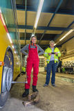 Woman, trainee, working in the bus Workshop Stock Photography