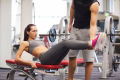 Woman with trainer doing abdominal exercise in gym Royalty Free Stock Photo