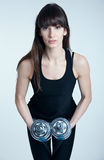 Woman trainer with dumbbells Stock Photos