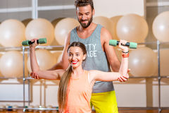 Woman with trainer in the fitness room Stock Images