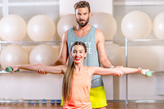 Woman with trainer in the fitness room Royalty Free Stock Photo