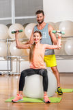 Woman with trainer in the fitness room Royalty Free Stock Photography