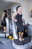 Woman on trainer machine in sport gym Royalty Free Stock Photos
