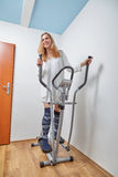 Woman on trainer Stock Image