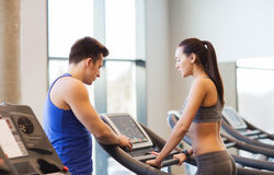 Woman with trainer on treadmill in gym Royalty Free Stock Photo