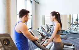 Woman with trainer on treadmill in gym Stock Photo