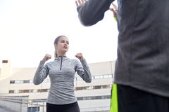 Woman with trainer working out self defense strike Royalty Free Stock Image