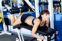 The woman on a training apparatus in sports club Royalty Free Stock Image